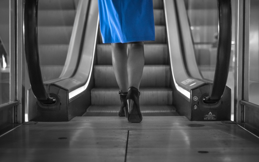 Woman approaching escalator