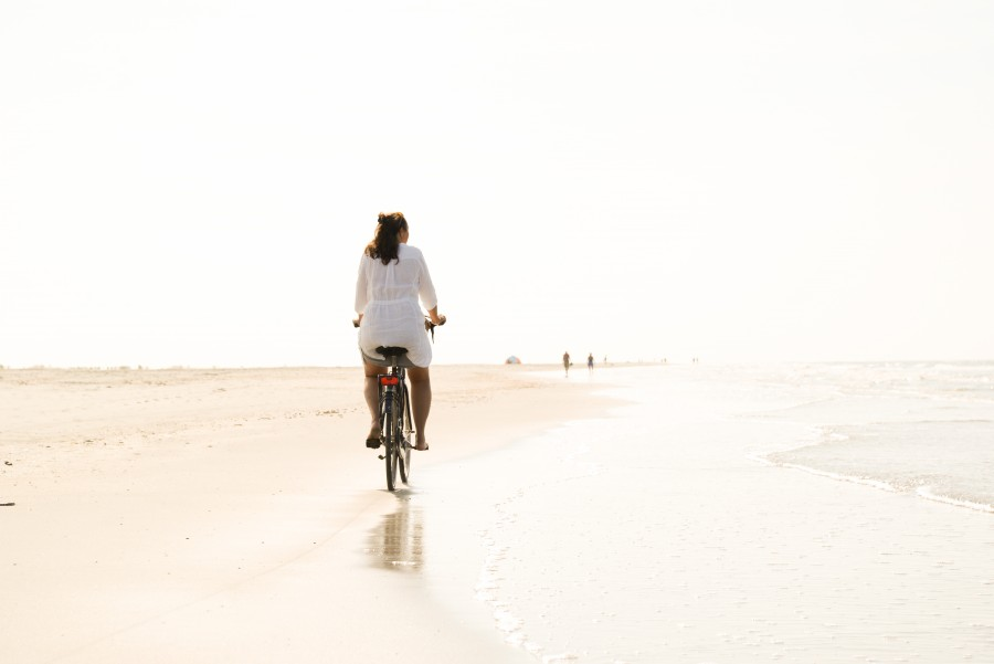 Riding a bike on the beach