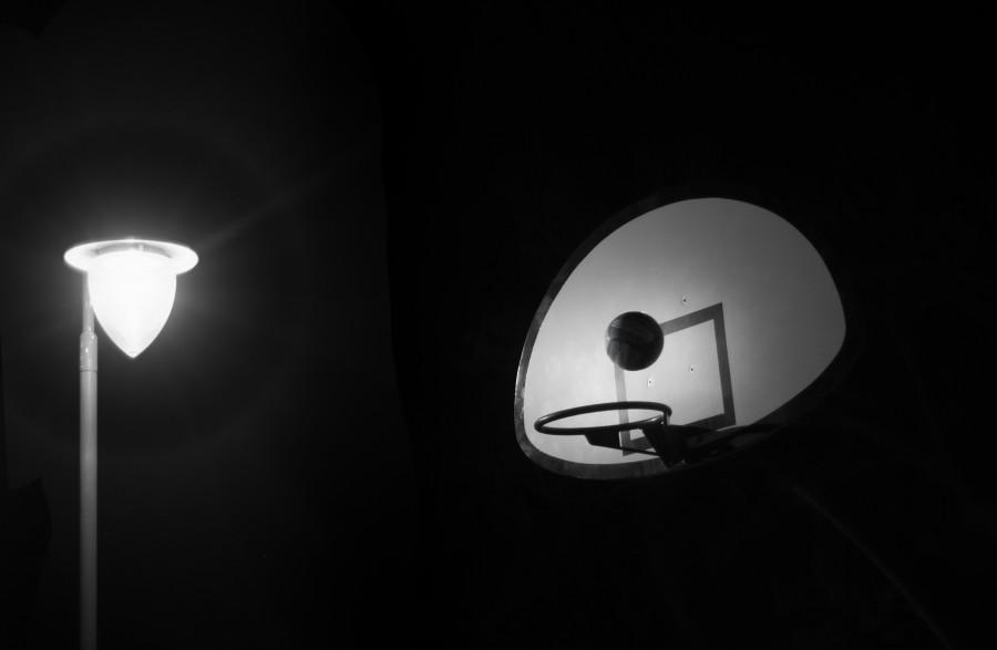 Shooting hoops at night