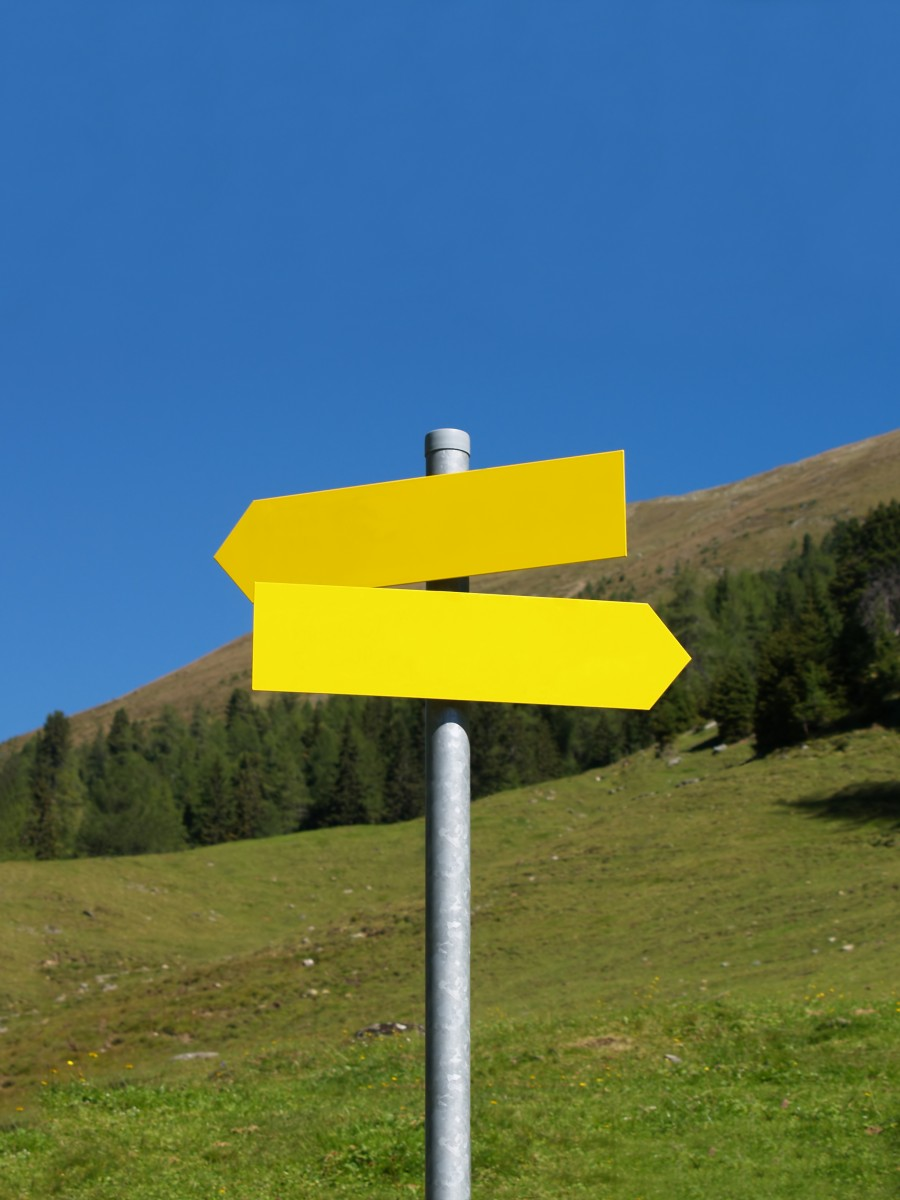 Yellow Signpost in the Mountains
