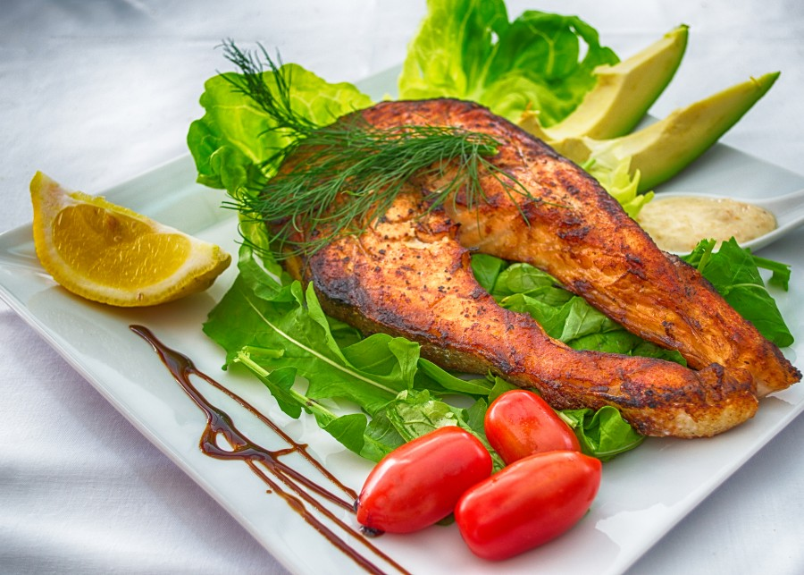 Plated Grilled Salmon Slice with Cherry Tomato, Lemon, Dip and Avocado