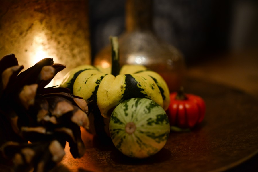 Pumpkins and a candle