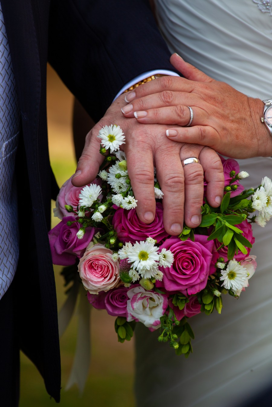 hands showing wedding rings